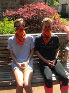 Twins on bench with bandanas